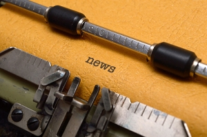 News text on typewriter