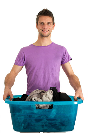 Young man doing the laundry