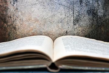 Open book against grunge background