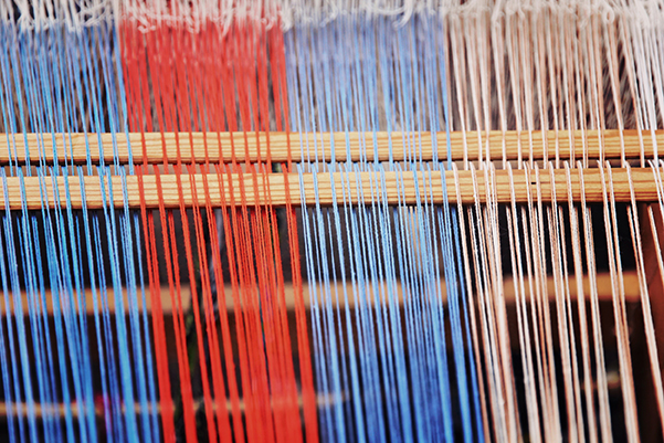 Multicolored Thread On A Weaving Loom Taken Closeup.