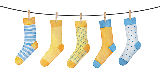 Various colorful socks on clothesline. Striped, checkered, polka